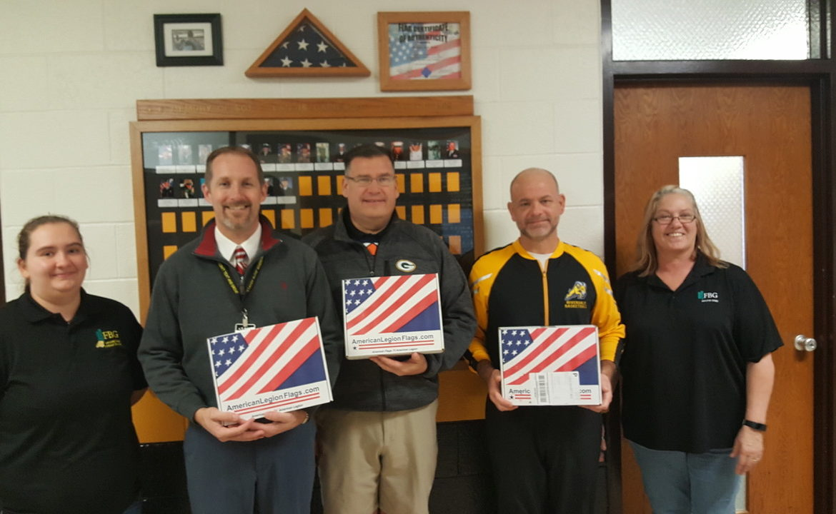 Riverdale Principals Rick D, Jim J and Josh T receiving gifted flags